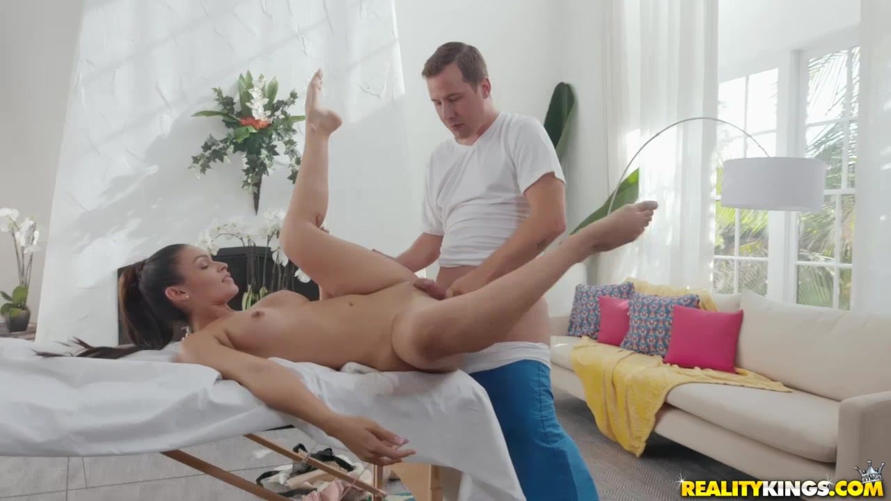 Hottie lies down on massage table to get a hard fuck