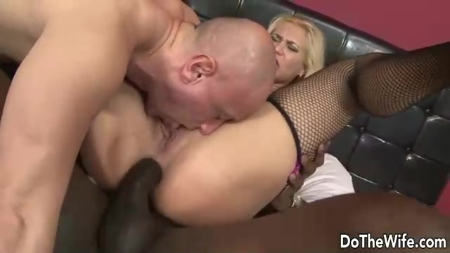 Bald-headed dude licks wife's pussy while black guy fucks her in the ass